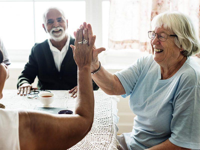 Senior women giving each other high five